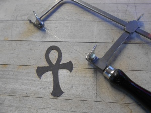 Sawn Ankh and my trusty saw.